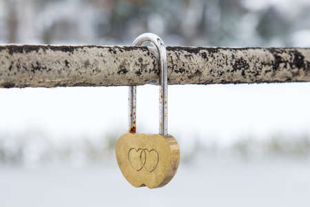 lock symbol: Wedding hinged lock with hearts on metal bar
