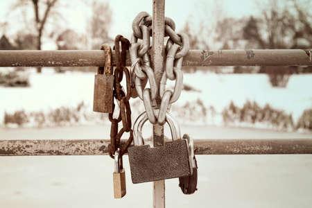 rusty chain: Old rusty padlocks hanging on metal chain Stock Photo