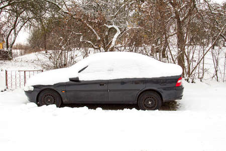 abandoned car: Abandoned car covered with snow in a cold weather
