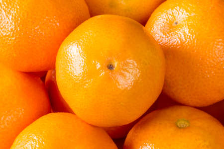 clementines: Food background of fresh healthy ripe orange clementines, tangerines or mandarins Stock Photo