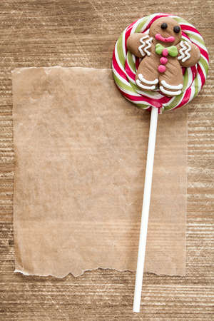 gingerbreadman: Christmas lollipop with gingerbread man and blank paper for copy-space