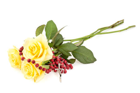 Rosary and yellow roses,isolated on white background