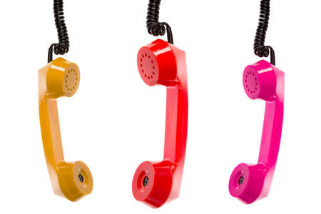Three colored telephone receivers isolated on white background