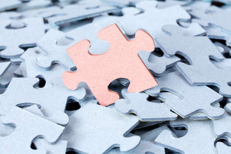 Jigsaw puzzle pile. Stand out from the crowd concept or be different Stockfoto