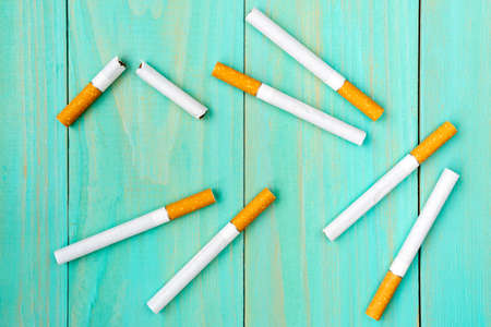 Quit bad habit, health care concept. No smoking.Cigarettes on blue wooden background.