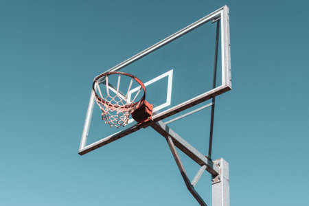Basketball ring and board. Low angle view. Filtered image. Stock fotó