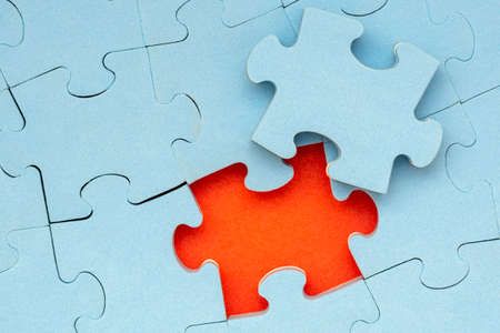 Completing final task, missing jigsaw puzzle piece and business concept Standard-Bild - 119419152