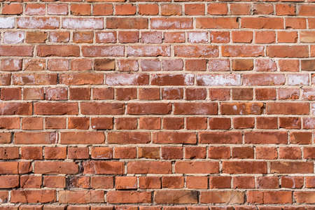Background of old vintage red brick wall Stock Photo