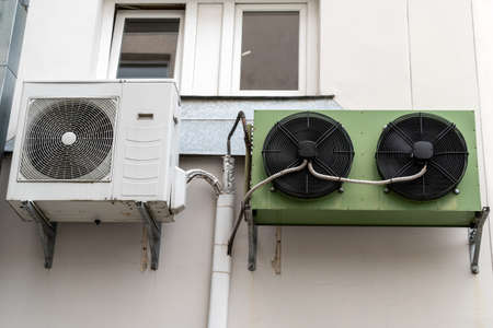 Air conditioning system installed outside on a building wall