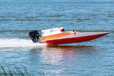 Speed boat go fast along the lake in powerboat competition