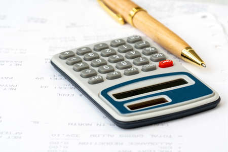 Close up of a calculator for calculate monthly benefits , business concept