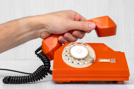Human hand picking up the phone. Customer service or communication concept Banque d'images - 130211692