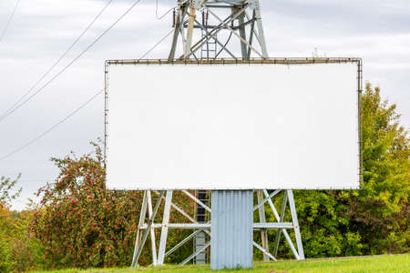 Blank billboard beside the high-voltage tower. Copy space.