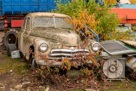 Old rusty car on the junkyard waiting for recycling or destruction Stok Fotoğraf
