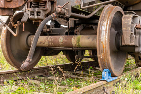 Railway brake shoe under the train wheel on the rails Imagens