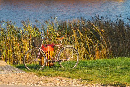 Old bicycle standing on the lake bank Reklamní fotografie