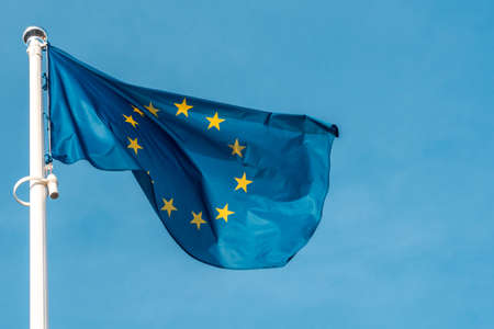 Blue European flag with twelve stars, they stand for the ideals of unity, solidarity and harmony among the peoples of Europe.