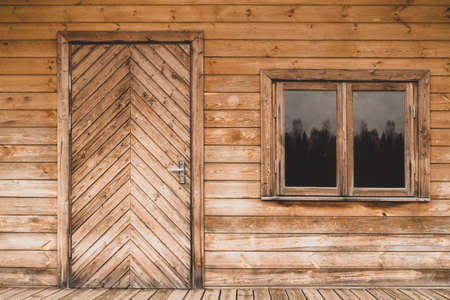 Door and window of an ecological wooden house Фото со стока - 134723946