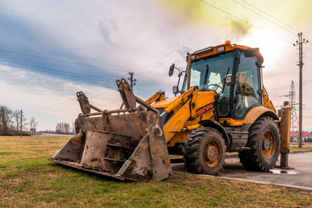 Excavator loader in a parking lot for road transport. A wheeled vehicle for lifting, digging and transporting goods. Stock Photo
