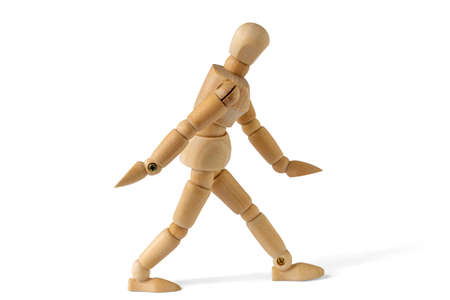 Wooden figure in walk action, isolated on white background