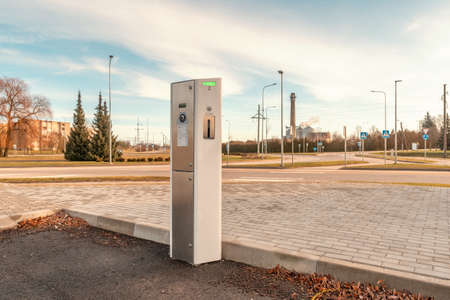 Small electro car charging station on the parking . Electric car charging battery. Alternative environmental energy for car. Environmental protection. Contraction global warming.
