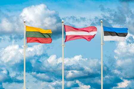 Flags of the Lithuania, Latvia and Estonia. Flags of the Baltic States waving on the sky background Standard-Bild