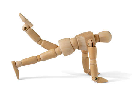 Wooden man doing fitness exercises , isolated on white background