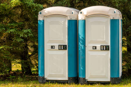 Portable toilets at an outdoor event in the public park