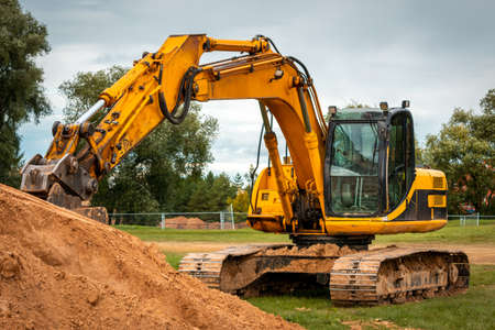Excavator during earthmoving at construction site. Ð¡onstruction machinery for excavation. Standard-Bild