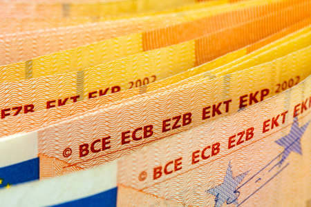 Close-up of fifty euro banknotes in a row. Selective focus, shallow DOF.