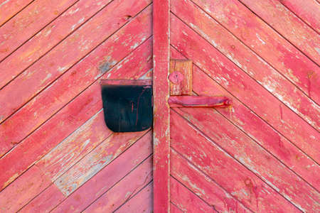 Old wooden door (gate) of the barn or garage. Can be used as the background or texture for photo editors