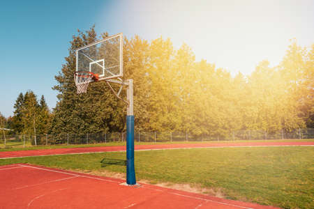 Open park basketball court on a sunny morning