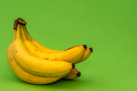 Ripe yellow bananas, which are a great source of magnesium, vitamin B6, and vitamin C. Фото со стока