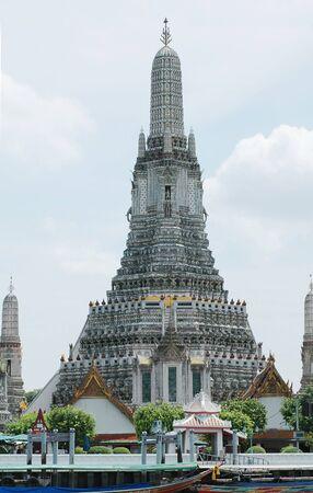 Wat Arun beside the Chao Phraya river in Bangkok, Thailand. Editorial