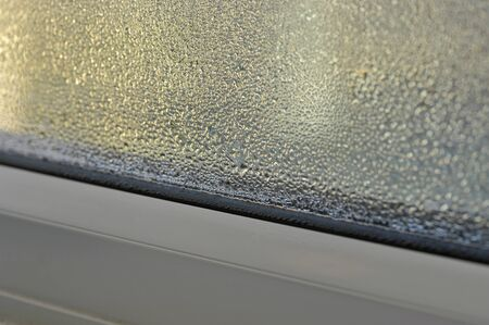 damp: Condensation and damp problem on the inside of a double glazed window.