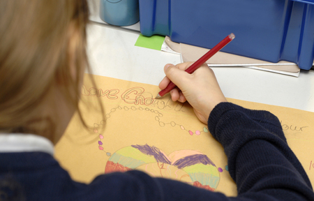 right handed: Pupil at work in the classroom. Stock Photo