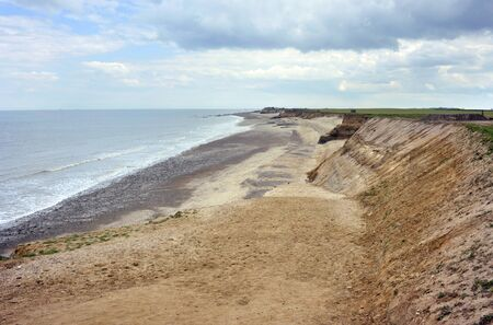 Changing landscape as the coastline and beach at Happisburgh in Norfolk suffers coastal erosion.