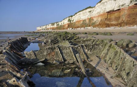 ship wreck: The cliffs, beach and ship wreck remains at Hunstanton in Norfolk, UK.