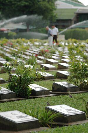 tend: Kanchanaburi war cemetery, Thailand.