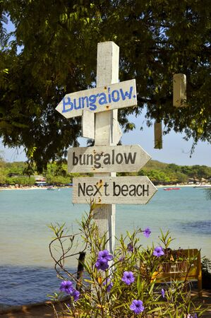 samet: Beach bungalow sign post on the holiday island of Koh Samet in Thailand.