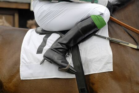 stirrup: Jockeys boot in the stirrup on a racehorse. Stock Photo