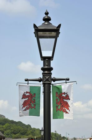Welsh flags, welsh dragons, on a lamp post in Porthmadog, Wales.