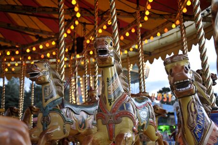 Vintage amusement fairground steam gallopers also called carousel or merry go round horse ride.