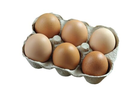 Free range brown eggs in a recycled paper moulded or molded pulp cardboard egg box packaging.