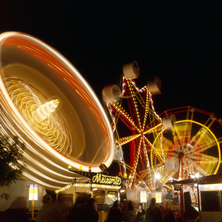 Kingston upon Hull fair at night with fairground ride movement, Hull, East Riding of Yorkshire, UK. Editorial