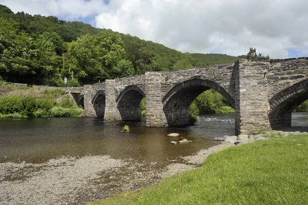 The Stone bridge and River Dee in the village of Carrog, Dee Valley, Denbighshire, Wales, UK.