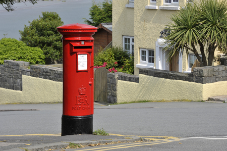 Elizabeth II red post office mail box in Criccieth, North Wales, UK.