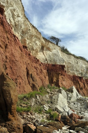 The cliffs, beach and bedrock outcrops along the coast at Hunstanton in Norfolk, UK. Stock Photo