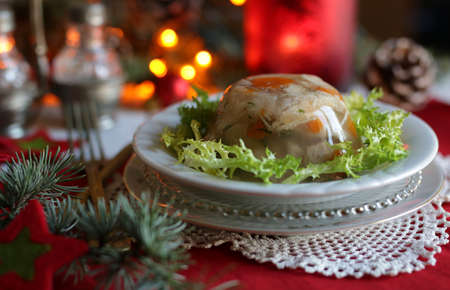 Aspic jellied meat with vegetables on Christmas background