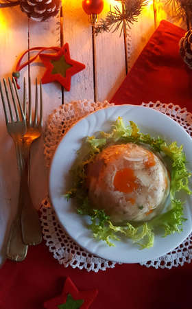 Aspic jellied meat with vegetables on Christmas background Stok Fotoğraf - 130611344